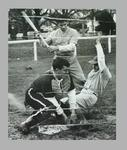 Black and white photograph,  three members of the Victorian Baseball team, competing in a practice match.