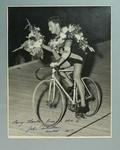 Black and white photograph of cyclist John Robertson, winner 1957 Austral Wheel Race, with inscription to Eric Gibaud, and 'The Sun' newsclipping verso.