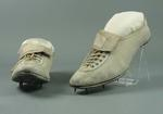 White leather spikes, worn by Doris Carter at 1936 Olympic Games