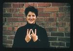 Colour slide of Dawn Fraser, holding both hands in victory sign
