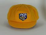 Cricket cap, yellow with Australian Cricket Board crest, made by Albion C&D