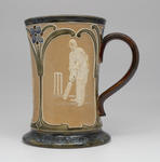Tankard, images of cricketers in relief