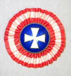 Badge, white cross on blue with red and white ruffled surround
