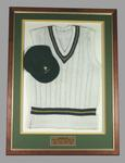 Framed South African Cricket Team vest and cap belonging to Mike Procter