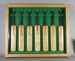 Seven autographed miniature cricket bats framed together - teams of cricket nations.