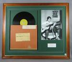 Framed display of a vinyl record and photograph of Maureen Caird, 1968 Olympic Games