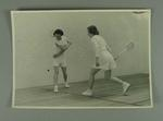 Photograph of two women playing squash, c1950s