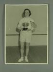 Photograph of Rae Maddern with New Zealand squash championship trophy, 1953