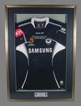 Framed soccer jersey - Melbourne Victory, Grand Final 18 February 2007 - associated with team captain Kevin Muscat