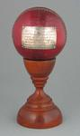 Cricket ball trophy, presented to Betty Wilson by Australian Womens Cricket Council - February 1958