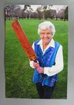 Colour photograph of Betty Wilson holding a cricket bat taken for Melbourne Times article of August 10 2005.