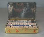 Griffiths Sweets Tin depicting the sports of the 1956 Olympic Games and a view of Melbourne city