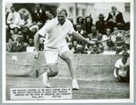 Black and white press photograph of John Bromwich during the men's singles final at the Seaside Championships, 1949
