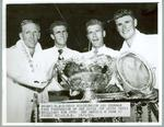 Black and white press photograph of John Bromwich, Ken McGregor, George Worthington and Frank Sedgman after being presented with the David Cup, 1950.