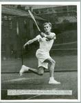 Black and white press photograph of American tennis player Art Larsen during practice for the N.S.W. Championships, 1950.