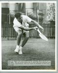 Black and white press photograph of American tennis player Dick Savitt during practice for the N.S.W. Championships, 1950.