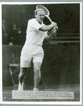 Black and white press photograph of tennis player John Bromwich during the quarter final of the Australian Singles Championships, 1950.