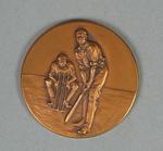 Bronze coloured medallion presented to SJ McCabe, 1938