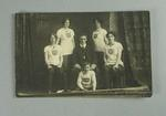 Postcard, image of four women, a man and boy - Albert Park Rowing Club c1912