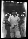 Negative, depicts batsman walking onto a ground c1932